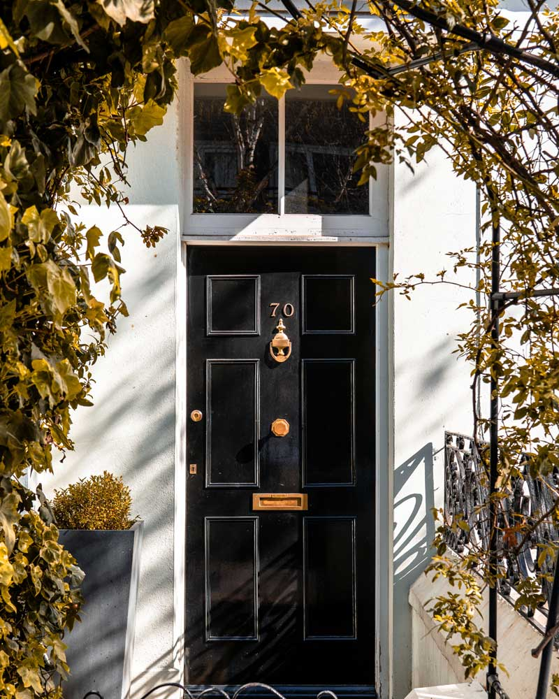 Black front door with brass knocker